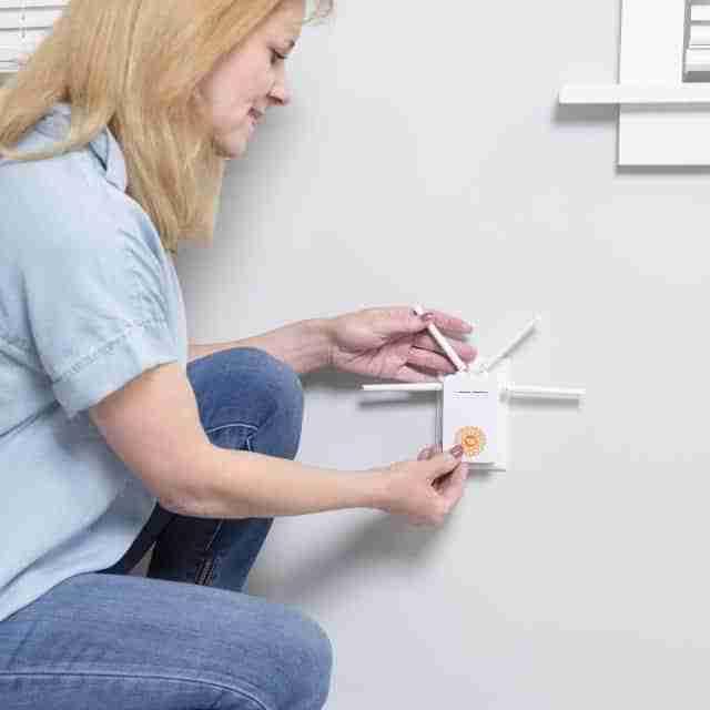 woman applying smartdot on router